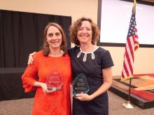 Amanda Gluski and Dr. Judith Gordon holding their awards.