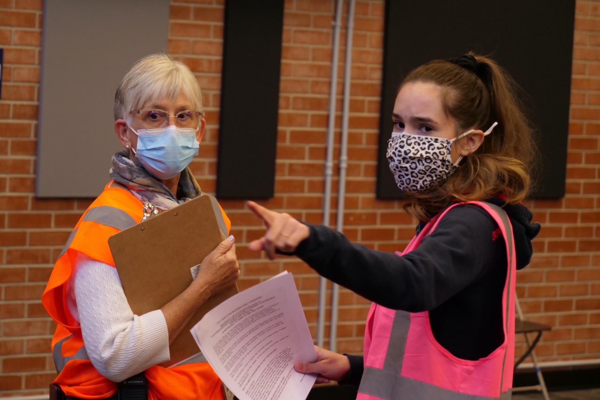 Sherry Daniels guides student volunteer