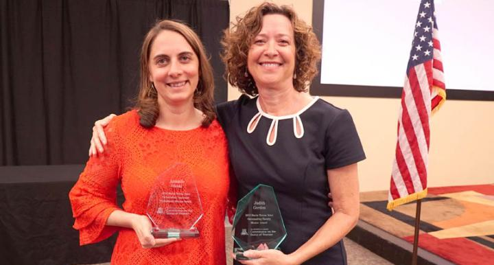 Amanda Gluski and Dr. Judith Gordon holding their awards.